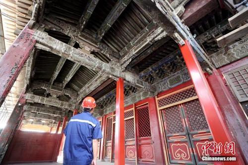 资料图:北京故宫养心殿修缮项目现场。中新社记者 张宇 摄