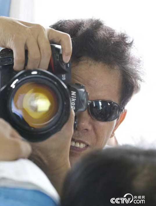 生平喜爱拍照、作品无数的童汉芳先生