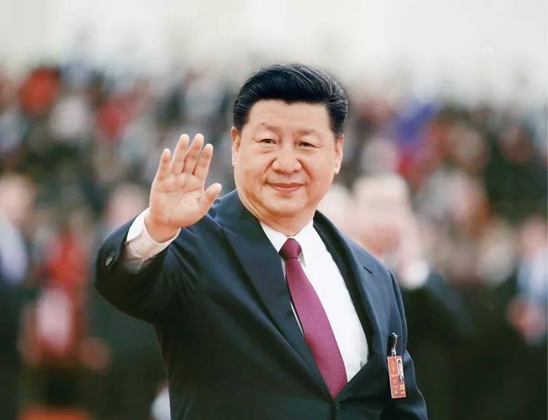 2018年3月20日,第十三届全国人民代表大会第一次会议在北京人民大会堂闭幕。这是习近平向代表挥手致意。  新华社记者  兰红光/摄