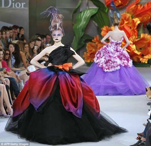 Full-skirted dresses had layers of degradé petals and ruffles, making them look like giant flowers