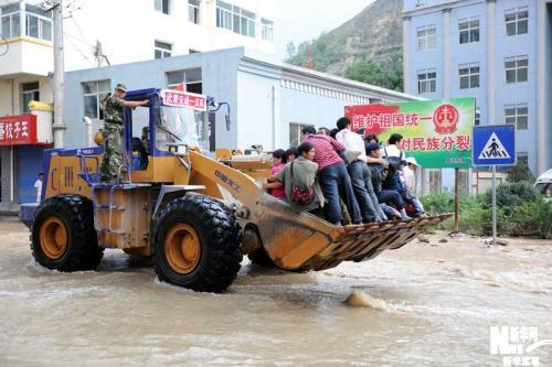 The death toll from rain-triggered landslides in Northwest China's Gansu Province has risen to 337. Torrential rain began lashing Zhouqu county Saturday night.