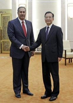 China's Premier Wen Jiabao, right, shakes hands with Qatar's Prime Minister Sheikh Hamad Bin Jassim Bin Jabr Al-Thani during a meeting at the Great Hall of the People, in Beijing, China, Wednesday, May 12, 2010.(AP Photo/Jason Lee, Pool)