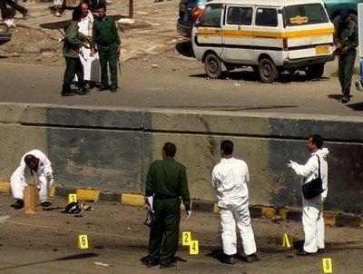 YemenipoliceforensicofficersinspectthesceneofasuicidebombingthattargetedtheconvoyoftheBritishambassadorinSanaaonApril26,2010.Al-QaedaintheArabianPeninsula(AQAP)claimedresponsibilityfortheApril26attackonBritain'senvoytoYemenTimothyTorlotinastatementpostedTuesdayonjihadistforums,theUSmonitoringgroupSITEsaid.(AFP/File/MohamedHuwais)