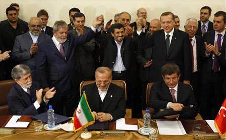 IranianPresidentMahmoudAhmadinejad,center,joinshandswithhisBraziliancounterpartLuisInacioLuladaSilva,secondleft,andTurkishPrimeMinisterRecepTayyipErdogan,afterthethreenationssignedanuclearfuelswapdealinTehran,Iran,onMonday.(VahidSalemi/AP)