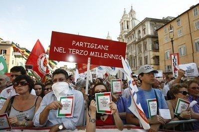 Demonstrators protest against a proposed government bill that they consider a threat to the free flow of information in Italy, during a rally in Rome,Thursday, July 1, 2010. Striking magistrates added their weight to a demonstration by journalists against a proposed law that would both limit investigators' ability to tap phones and trace calls during criminal investigations as well as punish journalists who print information from such calls.(AP Photo/Pier Paolo Cito)