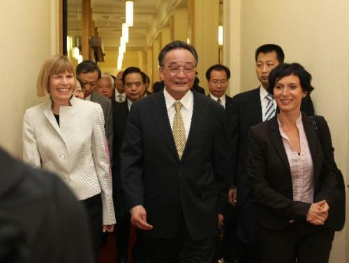 Wu Bangguo (C), chairman of the Standing Committee of China's National People's Congress, the country's top legislature, meets with Pascale Bruderer (R), president of the National Council of the Swiss Federal Assembly, and Erika Forster-Vannini (L), president of the Council of States of the Swiss Federal Assembly, in Bern on July 17, 2010.(Xinhua/Ju Peng)