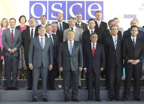 Kazakhstan's President Nursultan Nazarbayev (C, bottom) and the Organisation for Security and Cooperation in Europe (OSCE) Foreign Ministers pose for photo during their informal meeting at Ak-Bulak resort, 35 km (22 miles) southeast of Almaty July 17, 2010.(Xinhua/Reuters Photo)