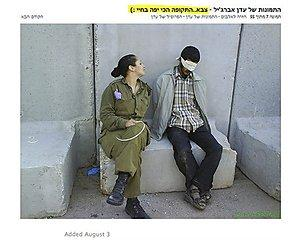 "In this undated photo, originally posted on a Facebook page belonging to Eden Aberjil, and taken from the Israeli blog site sachim.tumblr.com, an Israeli army soldier poses in front of blindfolded men identified in the Israeli media as Palestinian prisoners. The Hebrew in the top right translates as, ""Eden Arberjil's photos - army...the best time of my life."" Israeli news media and bloggers have identified the soldier in the photos as Aberjil. (AP Photo/sachim.tumblr.com)"