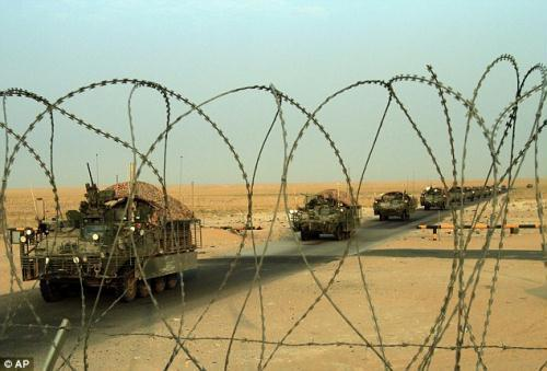 Coming home: A column of U.S. Army Stryker armored vehicles cross the border from Iraq into Kuwait.