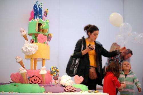 "An art piece is seen at an exhibition entitled ""Art you can Eat... Cake Britain"" in a central London gallery, Aug. 27, 2010. The exhibition, according to the organizers is the world's first ever entirely edible art exhibition and teamed the UK's most creative bakers with artists who want to create art using sugar, cake and other sweet stuff. All exhibits will be devoured over the three days by visitors to the exhibition and proceeds will go to charity organizations.(Xinhua/AFP Photo)"