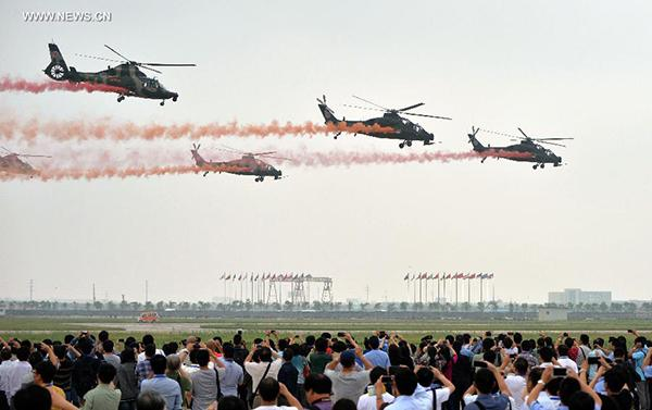 Visitors Look At The Performance Of Aerobatic Flight At The Second China Helicopter Exposition In Tianjin North China Sept