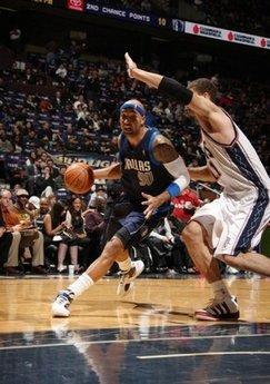 Drew Gooden (left) of the Dallas Mavericks drives against Brook Lopez of  the New fd49fe5ff