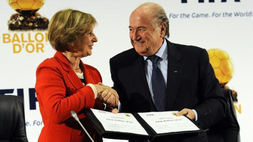 FIFA President Sepp Blatter (right) shakes hands with President of the Amaury Group, Marie-Odile Amaury, after the creation of the FIFA Ballon d'Or award during a FIFA and France Football joint press conference on Monday in Sandton, near Johannesburg.(Stephane de Sakutin/AFP/Getty Images)