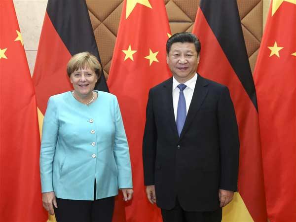 BEIJING, June 13, 2016 (Xinhua) -- Chinese President Xi Jinping (R) meets with German Chancellor Angela Merkel in Beijing, capital of China, June 13, 2016. (Xinhua/Pang Xinglei)