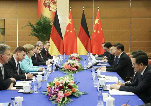 BEIJING, June 13, 2016 (Xinhua) -- Chinese President Xi Jinping meets with German Chancellor Angela Merkel in Beijing, capital of China, June 13, 2016. (Xinhua/Liu Weibing)