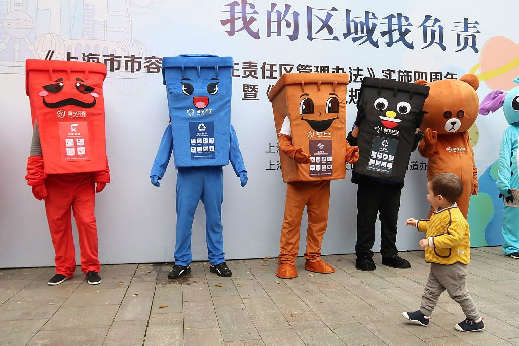 An activity that aims to raise public awareness of the importance of waste sorting is held in Shanghai in March. [Photo/VCG]