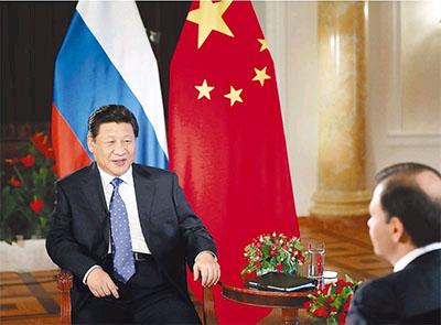 2014年2月7日,国家主席习近平在俄罗斯索契接受俄罗斯电视台专访。新华社记者 兰红光摄