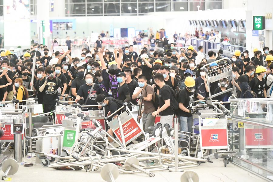 Violent radicals block a passage at Hong Kong International Airport in south China
