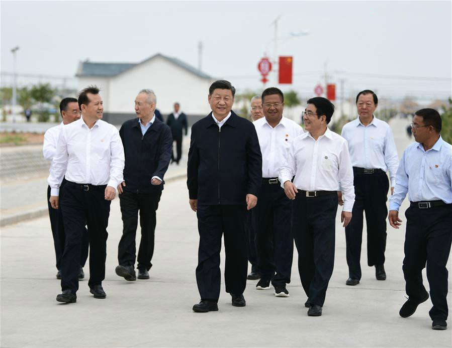 Chinese President Xi Jinping, also general secretary of the Communist Party of China Central Committee and chairman of the Central Military Commission, visits Huanghuatan community, which is home to rural residents relocated from environmentally vulnerable and impoverished areas, in Gulang County of Wuwei City, northwest China