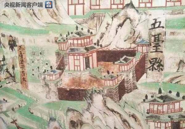"""这是第61窟,也叫""""文殊堂""""。洞窟的西壁绘有巨型的五台山图,长13.5米,高3.5米,被认为是莫高窟最大的佛教史迹画。(敦煌研究院提供)"""